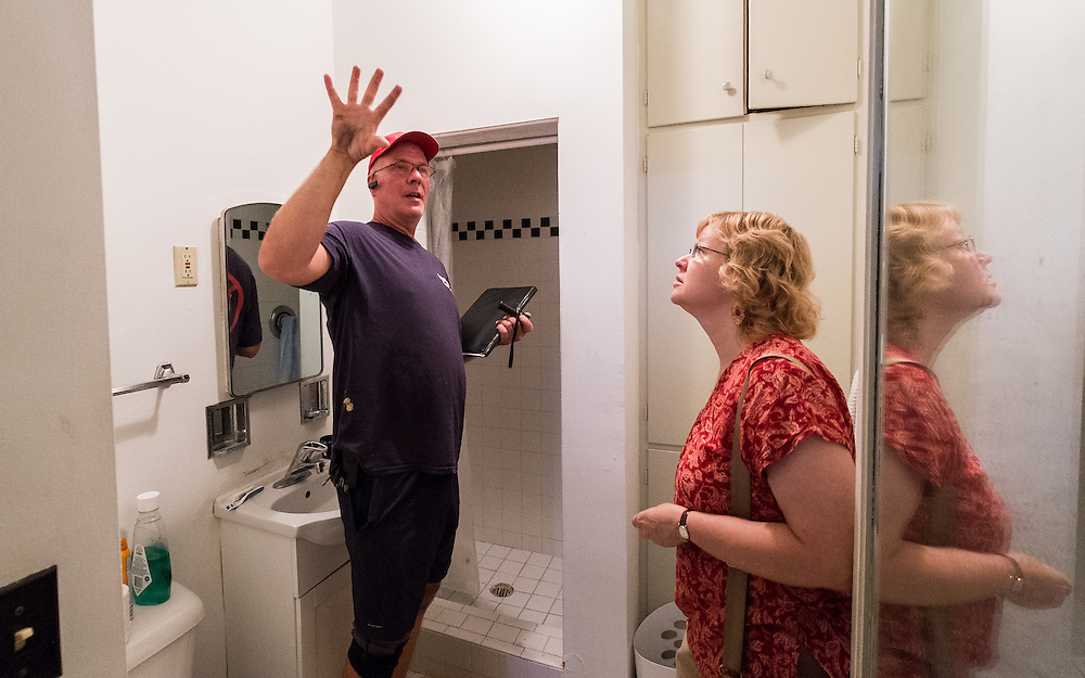 Michael Cumberledge, Jr. of Insulation Concepts discusses some of his findings with Ann Money Penny of Klein Penny Rentals during an energy audit at 47 West Washington Street on Tuesday, June 23, 2015.  Photo by Ohio University  /  Rob Hardin