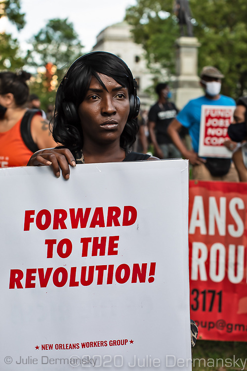Protester holding a sing on june 27, 2020., during a protest held by Take 'Em Down NOLA in Lafayette Square in New Orleans.