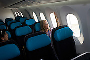 Media try out interior seating on the Boeing-manufactured 787 Dreamliner (N787BX) at the Farnborough Airshow. On its first flight outside of the US during its testing programme, the newest airliner in the Boeing aviation family, has arrived at the air show for a few days of exhibitions to the aerospace-buying community and the trade press. Later the public will have the chance to see this jet up close too. The Boeing 787 Dreamliner is a long range, mid-sized, wide-body, twin-engine  jet airliner developed by Boeing Commercial Airplanes. It seats 210 to 330 passengers, depending on variant. Boeing states that it is the company's most fuel-efficient airliner and the world's first major airliner to use composite materials for most of its construction