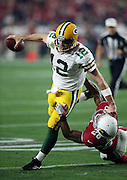 Green Bay Packers quarterback Aaron Rodgers (12) straight arms Arizona Cardinals cornerback Justin Bethel (28) as he attempts to break a tackle while running the ball in the second quarter play during the NFL NFC Divisional round playoff football game against the Arizona Cardinals on Saturday, Jan. 16, 2016 in Glendale, Ariz. The Cardinals won the game in overtime 26-20. (©Paul Anthony Spinelli)