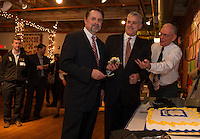 Mayor Ed Engler receives a slice of cake from Joe Kenney Executive Council of NH District 1 and Laconia President John Walker during the 100th birthday celebration at the Belknap Mill Wednesday evening.  (Karen Bobotas/for the Laconia Daily Sun)
