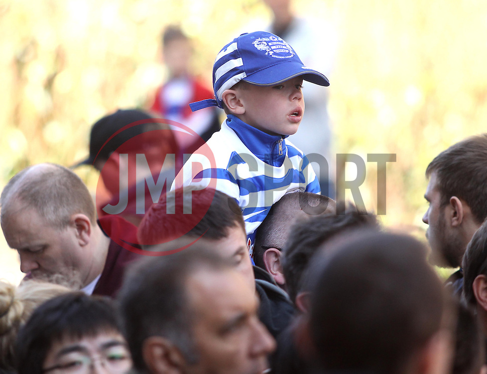 QPR fan tries to get a glimpse of the QPR and Chelsea players arriving - Photo mandatory by-line: Robbie Stephenson/JMP - Mobile: 07966 386802 - 12/04/2015 - SPORT - Football - London - Loftus Road - Queens Park Rangers v Chelsea - Barclays Premier League