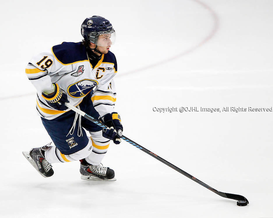 GEORGETOWN, ON - Oct 10, 2015 : Ontario Junior Hockey League game action between Buffalo and Georgetown, Zach Evancho #19 skates with the puck during the second period.<br /> (Photo by Brian Watts / OJHL Images)