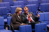 04 JUL 2002, BERLIN/GERMANY:<br /> Angela Merkel, CDU Bundesvorsitzende, und friedrich Merz, CDu, CDU/CSU Fraktionsvorsitzender, im Gespraech, Bundestagsdebatte zur Lage der Wirtschaft in Deutschland, Plenum, Deutscher Bundestag<br /> IMAGE: 20020704-01-062<br /> KEYWORDS: Gespr&auml;ch