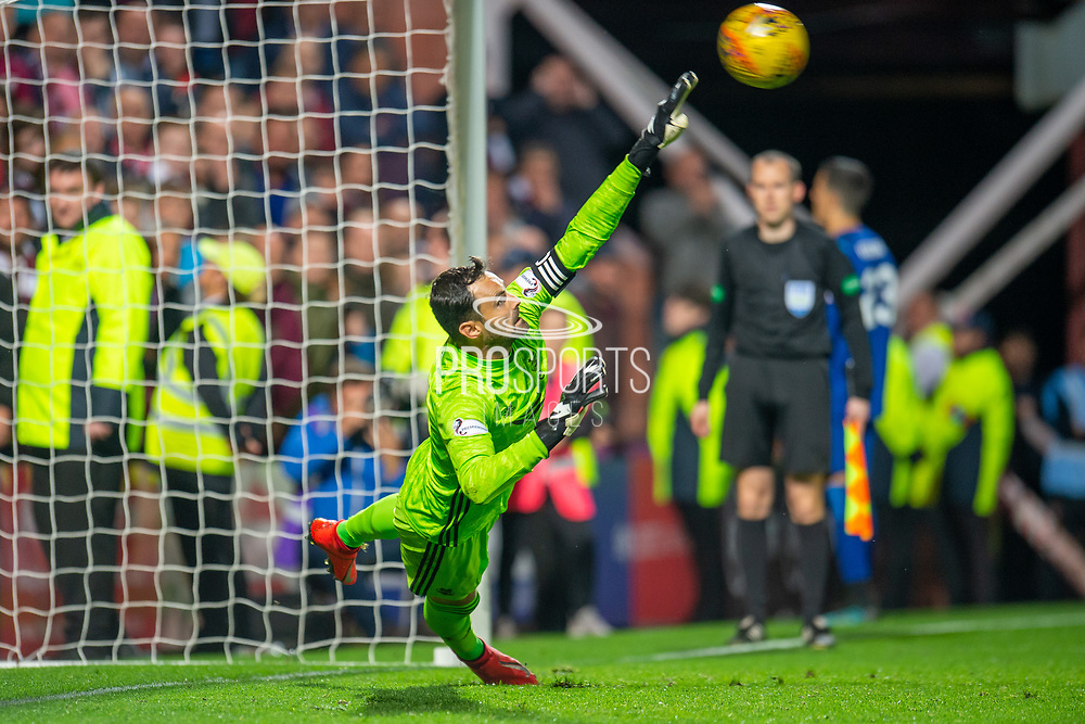 Joe Lewis (#1) of Aberdeen FC just fails to save a penalty during the penalty shoot out at the end of the Betfred Scottish Football League Cup quarter final match between Heart of Midlothian FC and Aberdeen FC at Tynecastle Stadium, Edinburgh, Scotland on 25 September 2019.