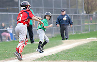 Cantins catcher Caleb Leighton chases Legions Connor Johnson back to third in a pickle during Laconia Little League Majors action Tuesday evening.   (Karen Bobotas/for the Laconia Daily Sun)