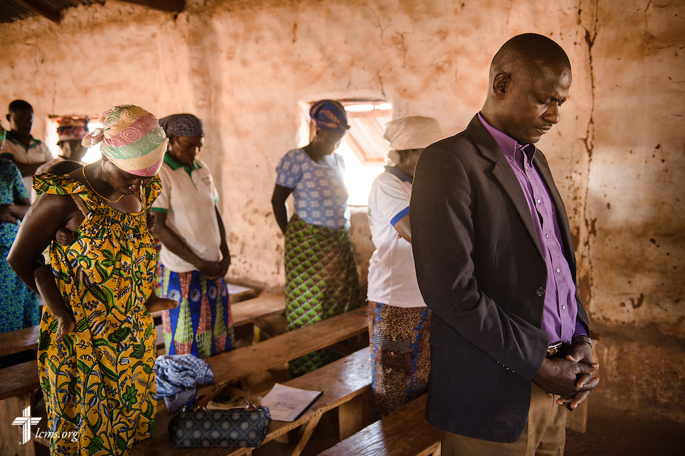 The Rev. Remi Lare Lambon, pastor in the Lutheran Church of Togo, leads a prayer during a literacy project class at the Lutheran Church of Togo in Kpierik on Tuesday, Feb. 14, 2017, in Kpierik, Togo. LCMS Communications/Erik M. Lunsford