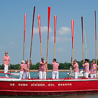 VENICE, ITALY - JUNE 05: Rowers from Voga Riviera del Brenta lift the oars to salute the passage of the Sensa procession in Bacino St Mark on June 5, 2011 in Venice, Italy. The festival  of la Sensa is held in May the Sunday after Ascension Day  following the traditional ceremony where the doge enacted the wedding of Venice to the sea. The ritual has recently been revived,