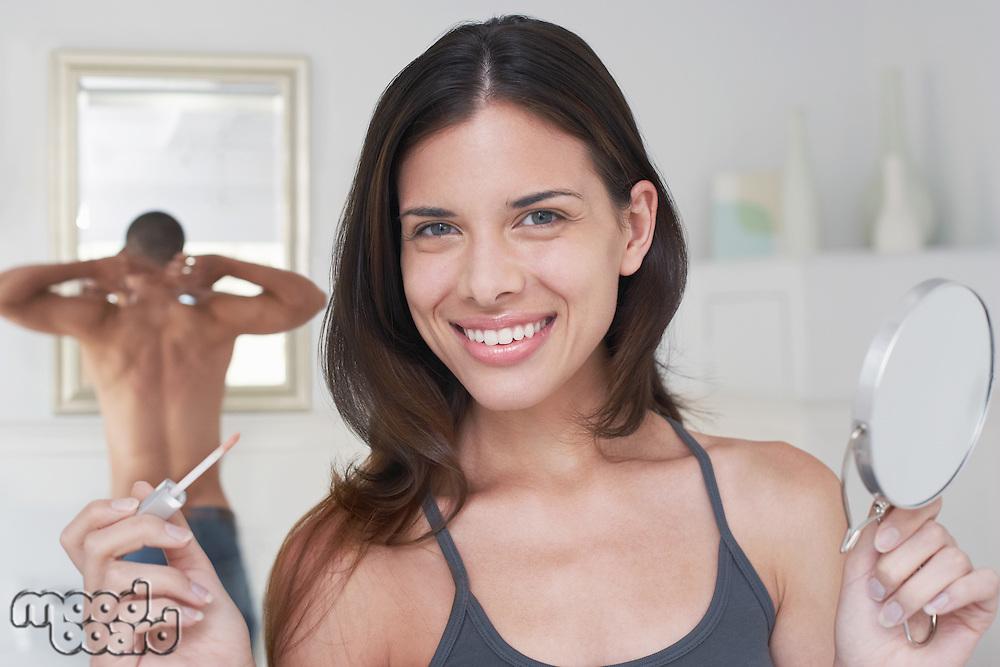 Woman and Man Getting Ready in Bathroom