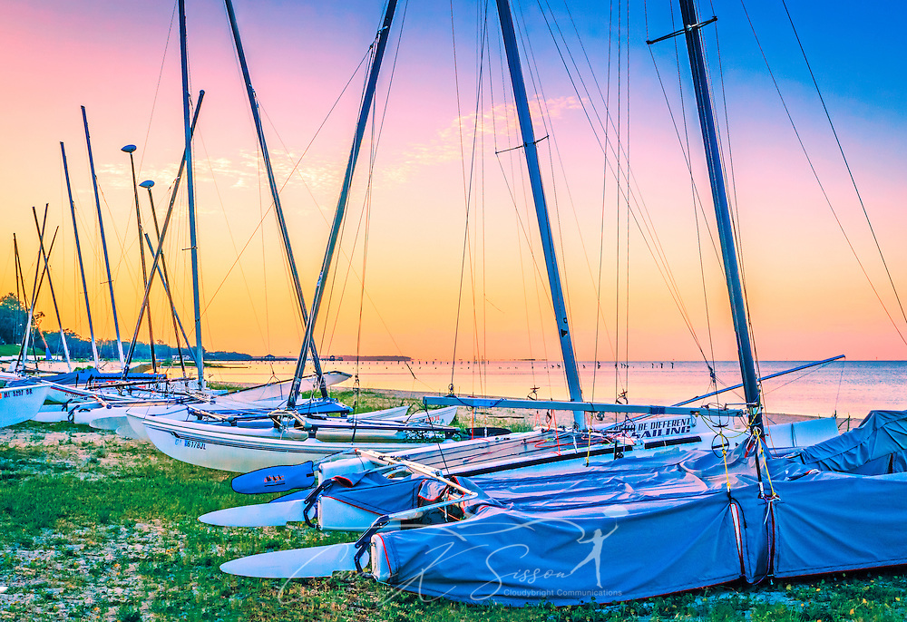 The sun rises over sailboats lined up along Front Beach at Ocean Springs Yacht Club, Aug. 26, 2014, in Ocean Springs, Mississippi. The yacht club was founded in 1969. The original clubhouse was destroyed by Hurricane Katrina in 2005 and rebuilt. (Photo by Carmen K. Sisson/Cloudybright)