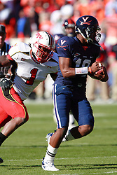 UVA first-year quarterback Jameel Sewell out runs Maryland's Erin Henderson (1) en route to a 36 yard touchdown run in the first quarter.  Despite Sewell's rushing touchdown and two passing touchdowns, UVA fell to  the Terps 28-26 in Charlottesville, VA on Saturday, October 14, 2006.