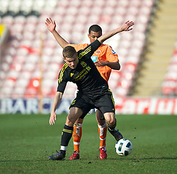 BLACKPOOL, ENGLAND - Wednesday, March 3, 2011: Liverpool's Alex Cooper and Blackpool's Kingsley Francis Reynolds during the FA Premiership Reserves League (Northern Division) match at Bloomfield Road. (Photo by David Rawcliffe/Propaganda)