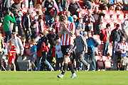 Rob Dickie at the final whistle during the Vanarama National League match between Cheltenham Town and Tranmere Rovers at Whaddon Road, Cheltenham, England on 26 September 2015. Photo by Antony Thompson.