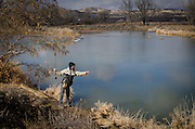 Conservationist and writer, Rachel Shockley, fly fishing on the San Juan River below Navajo Dam at the recently restored 80-acre Hammond Tract – a favorite among anglers. January, 2015.