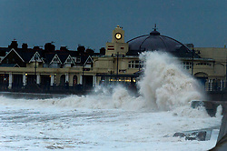 © Licensed to London News Pictures. 14/01/2020. Porthcawl, Bridgend, Wales, UK. On the day after Storm Brendan hit the Welsh coastline, massive waves pound the promenade in the small welsh seaside resort of Porthcawl in Bridgend, UK. The stormy weather is forecast to intensify again in south Wales this afternoon with gale force winds and more rain. Photo credit: Graham M. Lawrence/LNP