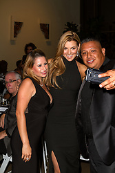 SANTA ANA, CA - OCT 10: Venezuelan model and actress Marjorie de Sousa takes a selfie with fans during ParaTodos Magazine 20th Anniversary Gala at the Bower Museum on 10th of October, 2015 in Santa Ana, California. Byline, credit, TV usage, web usage or linkback must read SILVEXPHOTO.COM. Failure to byline correctly will incur double the agreed fee. Tel: +1 714 504 6870.