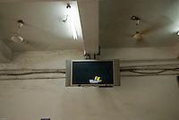 Screen at Old Delhi train station displaying a Windows sign.