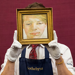 © Licensed to London News Pictures. 01/03/2019. LONDON, UK. A technician presents ''Head of a Boy'' by Lucian Freud, 1956, (Est. £4,500,000 - 6,500,000).  Preview of Sotheby's Contemporary Art Sale in their New Bond Street galleries.  Works by artists including Tracey Emin, Jenny Saville, Jean-Michel Basquiat and Andy Warhol will be offered for auction on 5 March 2019.  Photo credit: Stephen Chung/LNP