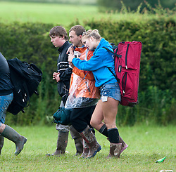 Campers head home after the weekend..T in the Park on Monday 11th July 2011. T in the Park 2011 music festival takes place from 7-10th July 2011 in Balado, Fife, Scotland..©Pic : Michael Schofield.