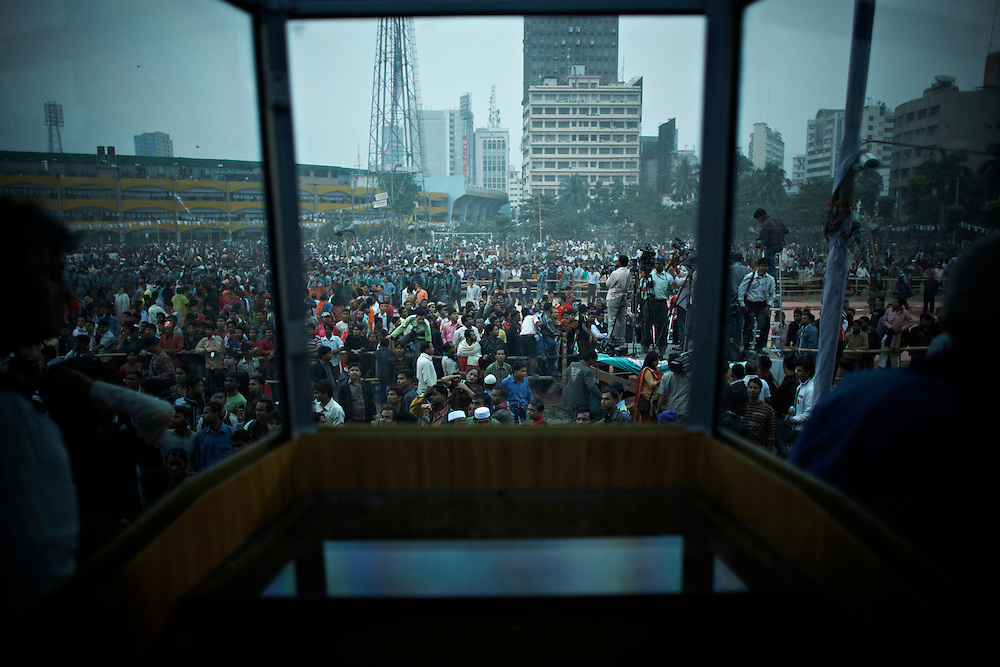 the view of Sheik Hasina, Palton, Dhaka, Bangladesh..Sheik Hasina chairperson of Awami League has just addressed thousands of supporters of the Grand Alliance from behind bulletproof glass at a political rally. Threats have been made on her life ahead of this election, and attempts have been made earlier...Bangladesh has finished with two years of emergency rule. The election results is compared to the landslide of 1970 that led to war and independence from Pakistan. .When preparations for the election started in late 2006, violent street-protests started, and led to a military backed interim government until the election happened under heavy security and watchful eyes on December 29th 2008...The past two years have seen a decrease of crime and corruption but also sparked violent student protests and curfews. Today  most people seem to be happy to return to some sort of normality. But in one of the poorest countries in the world where 80% live for less than a dollar a day, does it really matter who is in power? The circus is over, back to reality and putting food on the table...A blogger  from dhaka is quoted Ó we prefer messy democracy to military ruleÓ...Is this the end of night, a new dawn or yet another dusk?..Photo by: Eivind H. Natvig/MOMENT *** Local Caption ***