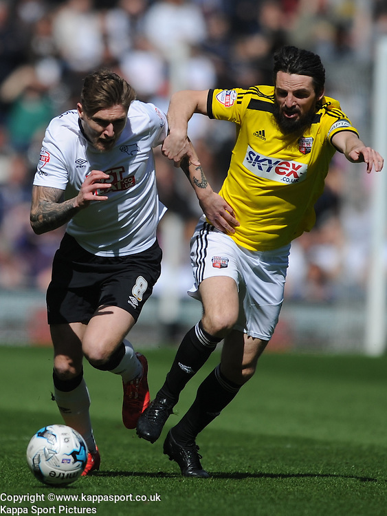Brentford Jonathan Douglas battles with Derby Jeff Hendrick, Derby County v Brentford, Sy Bet Championship, IPro Stadium, Saturday 11th April 2015. Score 1-1,  (Bent 92) (Pritchard 28)<br /> Att 30,050