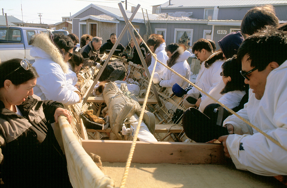 Whaling crew and their familys pray over their umiak before setting out to hunt Bowhead Whales in the Chukchi Sea off Barrow