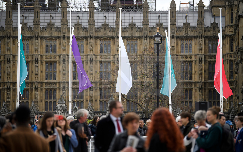 © Licensed to London News Pictures. 24/04/2018. London, UK. Suffragist colours fly outside Parliament during the unveiling of a statue of Millicent Fawcett in Parliament Square, London. Dame Millicent, a leading Suffragist and campaigner for equal rights for women, is the first woman to be commemorated with a statue in Parliament Square. Photo credit: Ben Cawthra/LNP