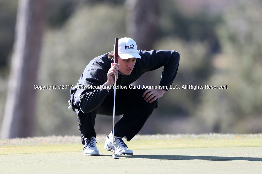 WILMINGTON, NC - MARCH 19: UNC Wilmington's Reese McFarlane lines up a putt on the Ocean Course fifth hole. The first round of the 2017 Seahawk Intercollegiate Men's Golf Tournament was held on March 19, 2017, at the Country Club of Landover Nicklaus Course in Wilmington, NC.