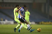 Sheffield Wednesday midfielder Sam Hutchinson (4) and Brighton defender, full back, Inigo Calderon (14) during the Sky Bet Championship match between Sheffield Wednesday and Brighton and Hove Albion at Hillsborough, Sheffield, England on 3 November 2015.
