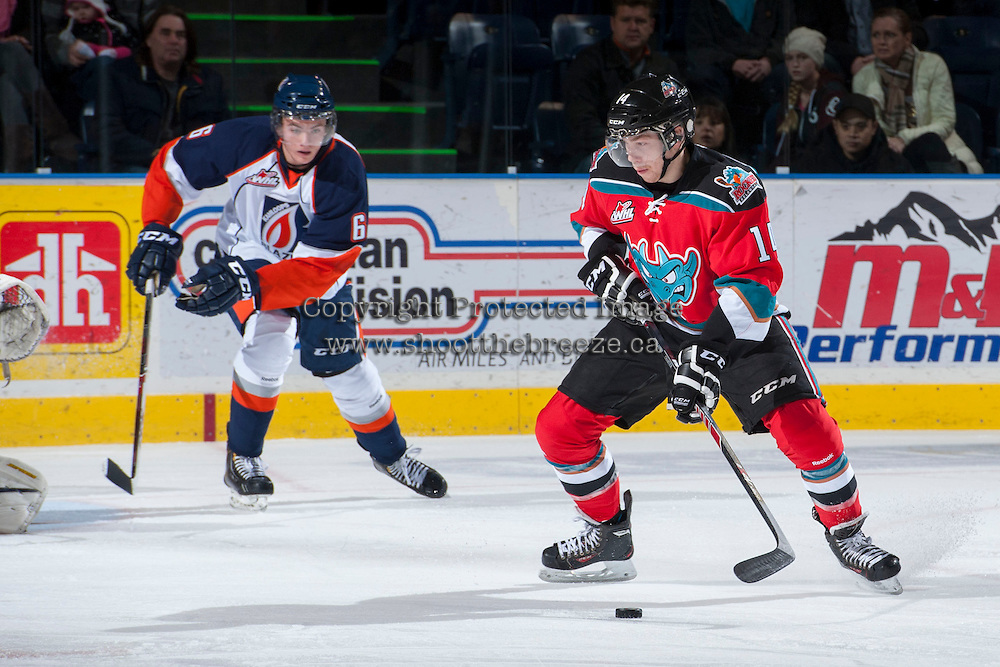 KELOWNA, CANADA - NOVEMBER 30: Rourke Chartier #14 of the Kelowna Rockets takes a shot against the Kamloops Blazers on November 30, 2013 at Prospera Place in Kelowna, British Columbia, Canada.   (Photo by Marissa Baecker/Shoot the Breeze)  ***  Local Caption  ***