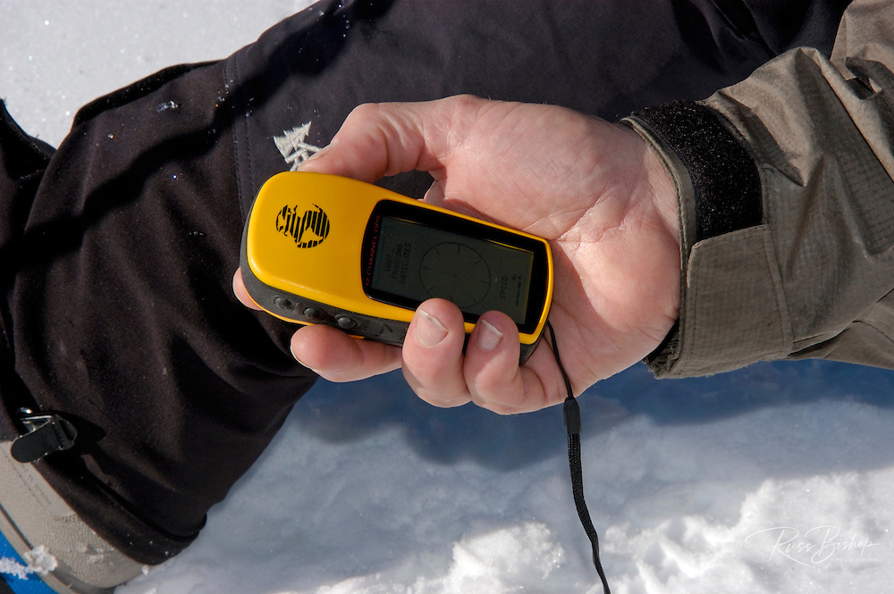 GPS (Global Positioning System) device in a person's hand, California