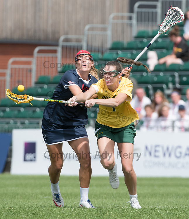 Australia's Abbie Burgessis challenged by USA's Taylor Cummings at the 2017 FIL Rathbones Women's Lacrosse World Cup, at Surrey Sports Park, Guildford, Surrey, UK, 14th July 2017.