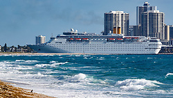 April 13, 2018 - Palm Beach, Florida, U.S. - The Grand Classica enters the Lake Worth Inlet to dock at the Port of Palm for it's first cruise. The Grand Classica, a 1,680-passenger ship, will join its sister ship Grand Celebration at the Port of Palm Beach as it begins sailing from the port to Freeport, Bahamas. (Credit Image: © Allen Eyestone/The Palm Beach Post via ZUMA Wire)