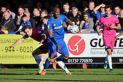 AFC Wimbledon striker Tom Elliott (9) battles for possession during the EFL Sky Bet League 1 match between AFC Wimbledon and Southend United at the Cherry Red Records Stadium, Kingston, England on 25 March 2017. Photo by Matthew Redman.