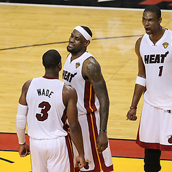 Jun 19, 2012; Miami, FL, USA; Miami Heat shooting guard Dwyane Wade (3) and small forward LeBron James (6) and power forward Chris Bosh (1) celebrate during the fourth quarter in game four in the 2012 NBA Finals against the Oklahoma City Thunder at the American Airlines Arena. Miami won 104-98. Mandatory Credit: Derick E. Hingle-US PRESSWIRE