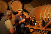 Domaine du Vissoux, Beaujolais..local workers take a pause amongst the barrels in the cellar... September 16, 2007..Photo by Owen Franken for the NY Times.