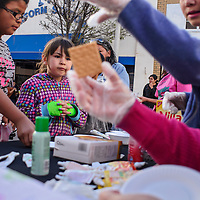 041214       Cable Hoover<br /> <br /> Taylor Yazzie, center, and Sunshine Silversmith decorate crackers at an edible art station during ArtsCrawl in downtown Gallup April, 12.