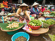 16 JUNE 2016 - PAKSE, CHAMPASAK, LAOS: Women sell vegetables in Dao Heuang Market, the largest market in Pakse. Pakse is the capital of Champasak province in southern Laos. It sits at the confluence of the Xe Don and Mekong Rivers. It's the gateway city to 4,000 Islands, near the border of Cambodia and the coffee growing highlands of southern Laos.      PHOTO BY JACK KURTZ