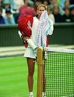 Tennis - 1998 Wimbledon Championships - Ladies  Singles - Natasha Zvereva v Steffi Graf - Third round<br /> <br /> 26/06/1998<br /> <br /> Steffi Graf  leaves the court after defeat to Natasha Zvereva on Centre court
