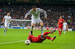 MADRID, SPAIN - Tuesday, November 4, 2014: Liverpool's captain Martin Skrtel tackles Real Madrid's Cristiano Ronaldo during the UEFA Champions League Group B match at the Estadio Santiago Bernabeu. (Pic by David Rawcliffe/Propaganda)