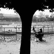 Individuals relax while respecting each others space in the open tranquil setting of the Jardin des Tuileries in Paris, France.  October 18, 2007. Photo Tim Clayton..Paris is often known as 'The City of Love' but like any major City in the world, the inhabitants often live a singular existence, going about their daily lives in relative solitude. Parisians are respectful of each others space, often courteous and polite while extremely conscious of their own image. While love can be seen openly around the streets of Paris, so can the separate lives of Parisians.