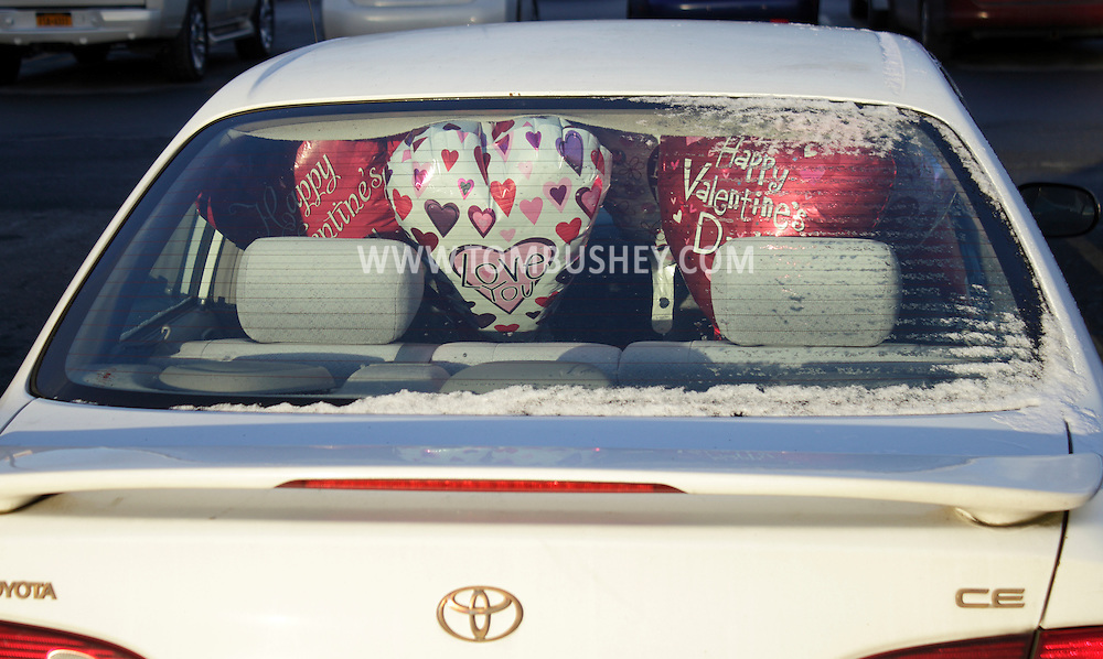 Town of Wallkill, New York - Valentine's Day balloons in the back of a car on Sunday, Feb. 12, 2012.