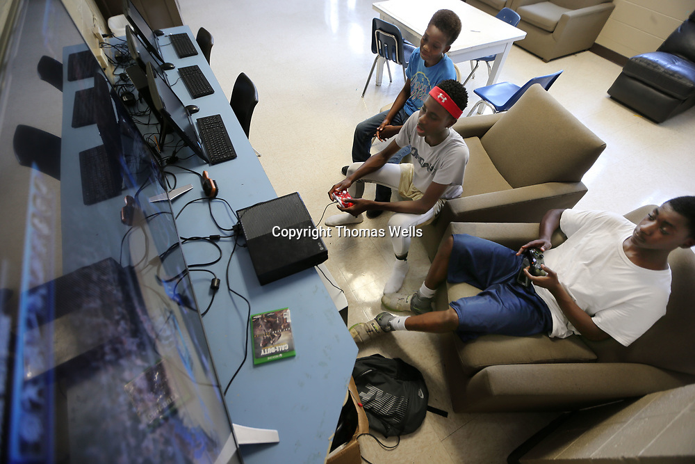 Braxton O'Neal, from left, Calen Triplett and Isiah Orr play the XBox in the newly remodeled game room at he Northside Boys & Girls Club on Wednesday.