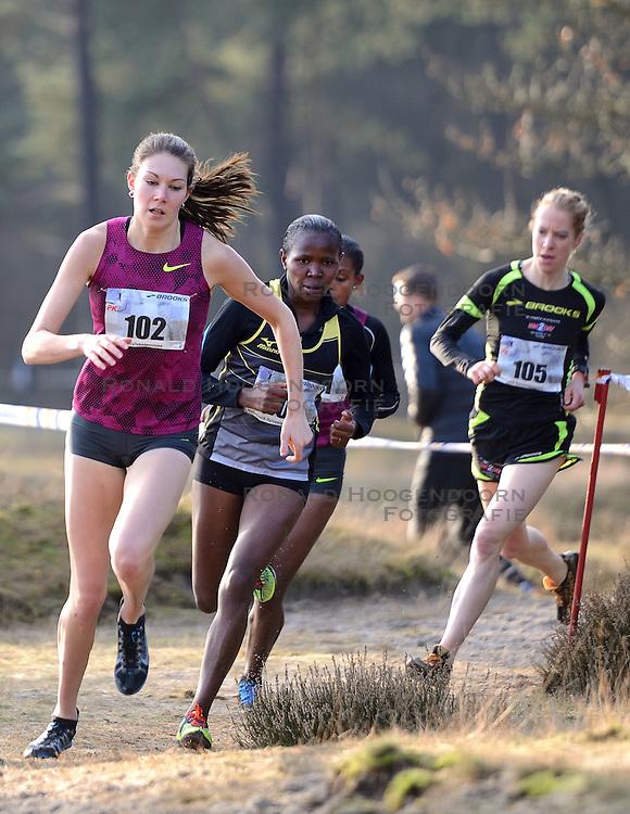 31-12-2014 NED: Rabobank Sylvestercross, Soest<br /> Bij de vrouwen ging de overwinning in de loop over 6 km door de Soester bossen naar Lucy Macharia (107). De Keniaanse was in de sprint Maureen Koster de baas.