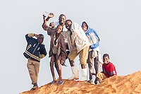 Young Mozambican  boys posing on a sand heap, Limpopo floodplain, Maputo Province, Mozambique
