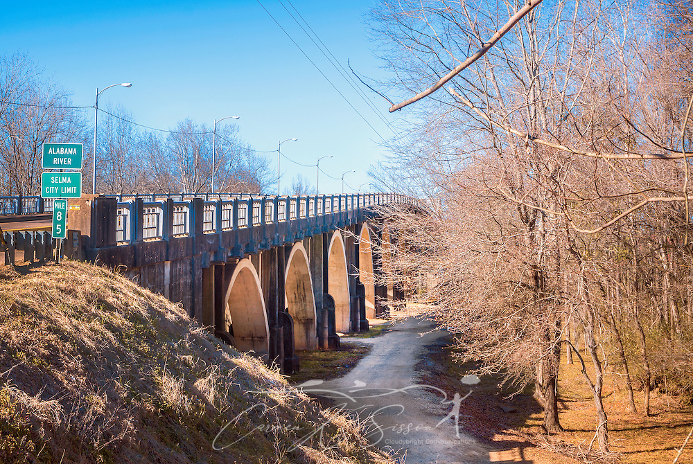 A winding trail leads visitors past the Edmund Pettus Bridge and through the Civil Rights Memorial Park, Feb. 7, 2015, in Selma, Alabama. The park was established in 2001 and includes murals and plaques honoring those who led the Civil Rights movement in Selma in the 1960's. (Photo by Carmen K. Sisson/Cloudybright)