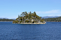 """Fannette Island, Emerald Bay State Park, is the only island in Lake Tahoe, USA. Lake Tahoe itself is split roughly vertical between California, West, and Navada, East.  Over a long period of time, Fannette Island has called many different names, including Coquette, Fanette, Baranoff, Dead Man's, Hermit's, and Emerald Isle. The island contains what is left of """"Tea House"""", a building constructed by the owner of Vikingsholm, Mrs. Lora Josephine Knight. 201304261870<br /> <br /> Copyright Image from Victor Patterson, 54 Dorchester Park, Belfast, UK, BT9 6RJ<br /> <br /> Tel: +44 28 9066 1296<br /> Mob: +44 7802 353836<br /> Voicemail +44 20 8816 7153<br /> Skype: victorpattersonbelfast<br /> Email: victorpatterson@me.com<br /> Email: victorpatterson@ireland.com (back-up)<br /> <br /> IMPORTANT: If you wish to use this image or any other of my images please go to www.victorpatterson.com and click on the Terms & Conditions. Then contact me by email or phone with the reference number(s) of the image(s) concerned."""