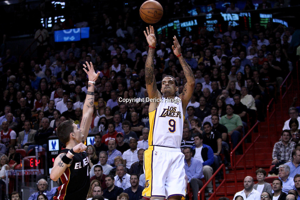 March 10, 2011; Miami, FL, USA; Los Angeles Lakers small forward Matt Barnes (9) shoots over Miami Heat shooting guard Mike Miller (13) during the second quarter at the American Airlines Arena.  Mandatory Credit: Derick E. Hingle