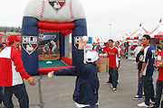 ANAHEIM, CA - APRIL 22:  Los Angeles Angels of Anaheim fans participate in a pitching event at FanFest before the game against the Baltimore Orioles on Sunday, April 22, 2012 at Angel Stadium in Anaheim, California. The Orioles won the game 3-2 in ten innings. (Photo by Paul Spinelli/MLB Photos via Getty Images)