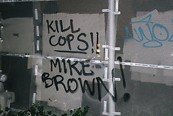 "Graffiti that says ""Kill Cops!"" and ""Mike Brown!"""